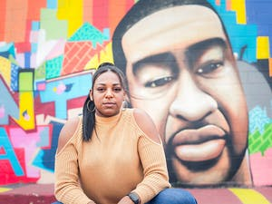 Erin Fairs in front of George Flloyd mural at Graffiti Park