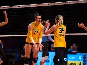 Cori Crocker high fives Kaylee Manns.