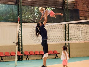 Sheilla with her daughters on the volleyball court.