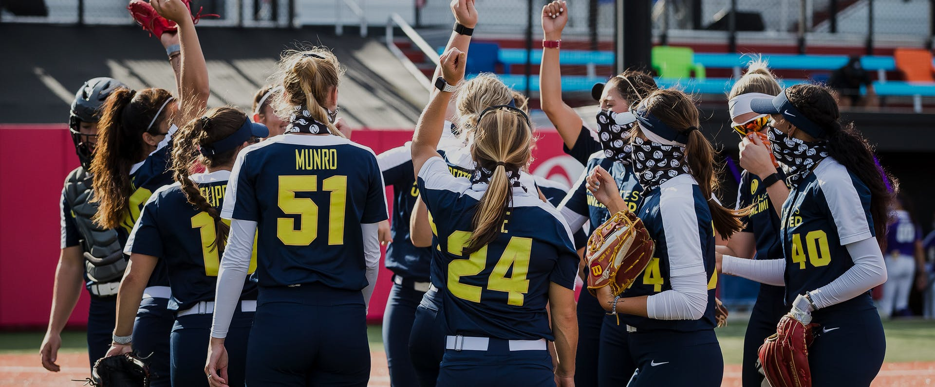 Athletes Unlimited Softball players cheer.