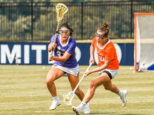 Athletes Unlimited Lacrosse players go for ball.